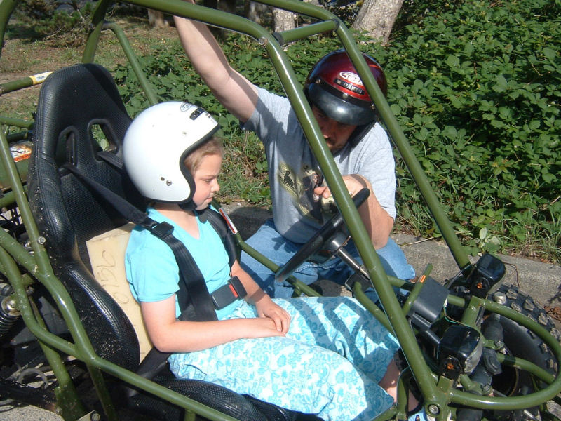 picture of Danaya in dune buggy