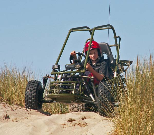 Picture of 11 year old Rett driving dune buggy