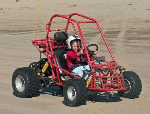 picture of Danaya driving a dune buggy, Oregon coast