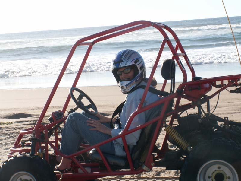 picture of Lori in a dune buggy on the beach