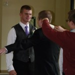 picture of groom getting lint rolled