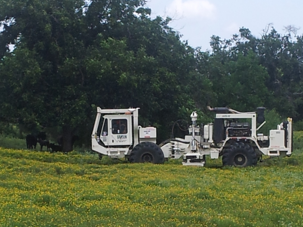 Picture of seismic vibrator truck in field