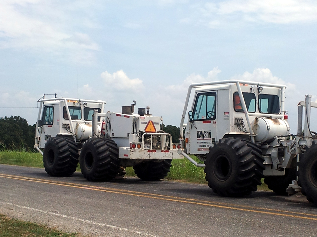 Picture of small seismic vibrator trucks