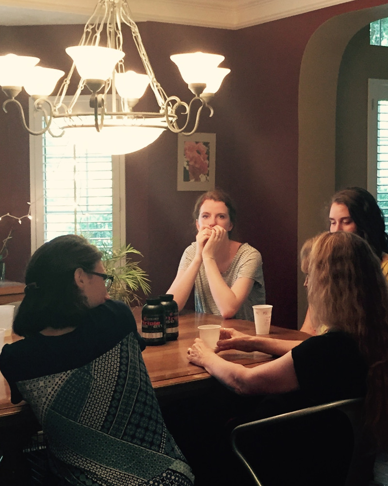 picture of ladies talking at dining room table